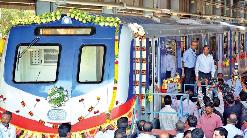 A.K. Mittal, chairman railway board, and S. Mani, general manager of Integral Coach Factory, on Tuesday inspect the new train designed for Kolkata metro.  (Photo: DC)