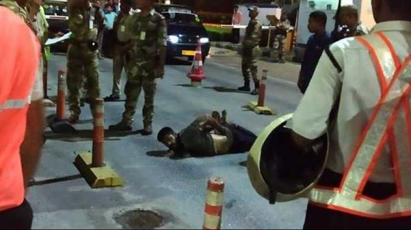 The man was pinned down on the road and tied with ropes. (Photo: Twitter | ANI)