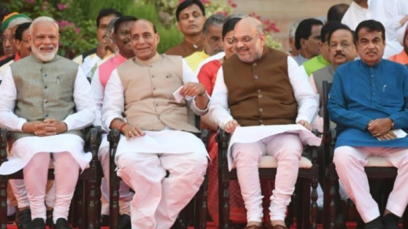 BJP leaders including Nitin Gadkari, Rajnath Singh, Nirmala Sitharaman, Dharmendra Pradhan, Prakash Javadekar and Smriti Irani who were a part of the first Modi government, also took oath as Cabinet Ministers. (Photo: AFP)