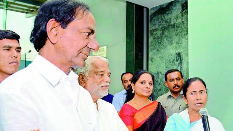 TRS president and TS Chief Minister K. Chandrasekhar Rao, party leaders K. Keshava Rao and K. Kavitha with Trinamul chief and West Bengal Chief Minister Mamata Banerjee in this file picture.