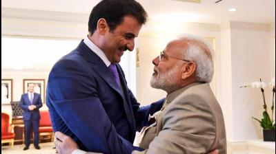 A close partner in India's extended neighbourhood, PM Narendra Modi had a good meeting with Amir of Qatar, Tamim Bin Hamad.  Discussed stepping up bilateral cooperation and matters of regional & global importance. (Photo: Twitter | @MEAIndia)
