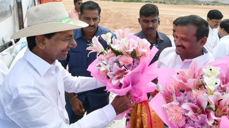Chief Minister K. Chandrasekhar Rao is being received by party leaders near Karvena reservoir in Mahbubnagar on Thursday.  (DC)