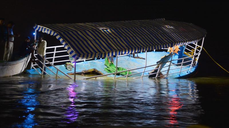 The ill-fated boat which was towed to the Ferry Ghat near Pavitra Sangamam in Vijayawada on Sunday. (Photo: DC)