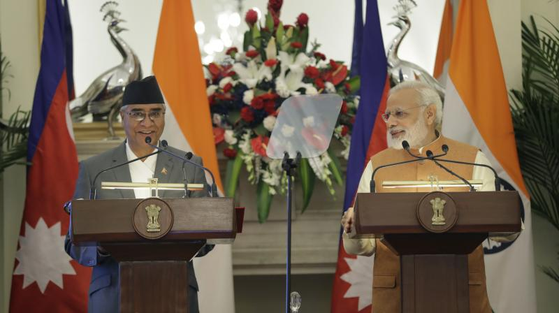 The pacts were signed after comprehensive talks between Prime Minister Narendra Modi and his Nepalese counterpart Sher Bahadur Deuba on strategic bilateral and regional issues. (Photo: PTI)