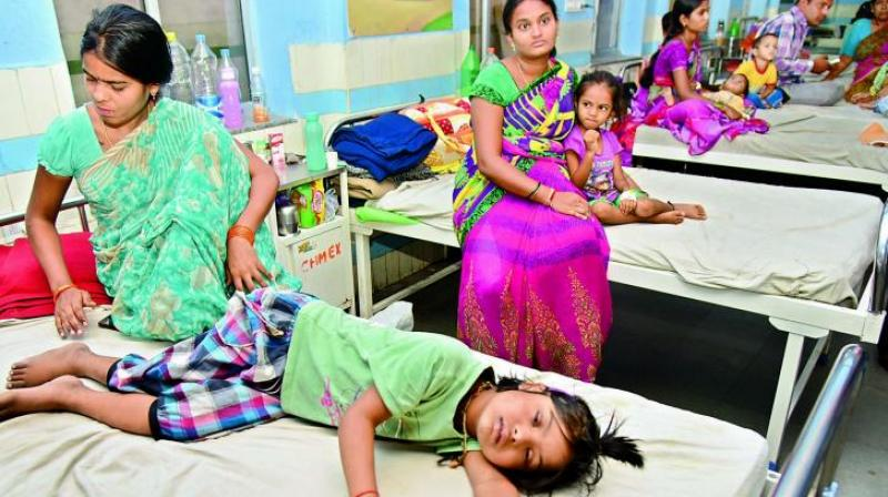 Children lying in a ward in Gandhi Hospital after suffering from chills and fever. (Photo: DC)
