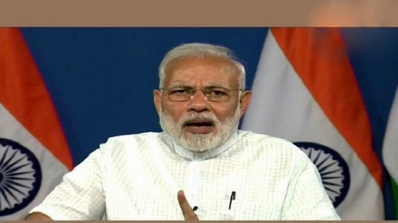 Prime Minister Narendra Modi said the focus is to ensure more women, 'divyang' (differently abled), people from SC, ST, OBC and minority communities get access to housing. (Photo: ANI | Twitter)