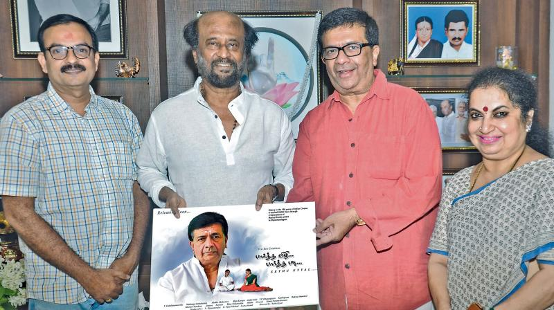 Rajinikanth with director Sethu Eyyal on his right and Y. G. Mahendra and Sudha Mahendra on his left.