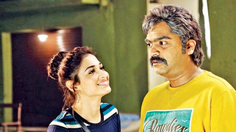 Tamannaah and STR in a still from the film.