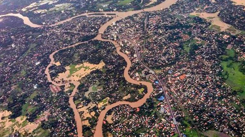 Terming the flood situation in Kerala following heavy rains as something never witnessed by the state since Independence, Union Home Minister Rajnath Singh on Sunday announced Rs 100 crore as an immediate central relief. (Photos: PTI/ AP)