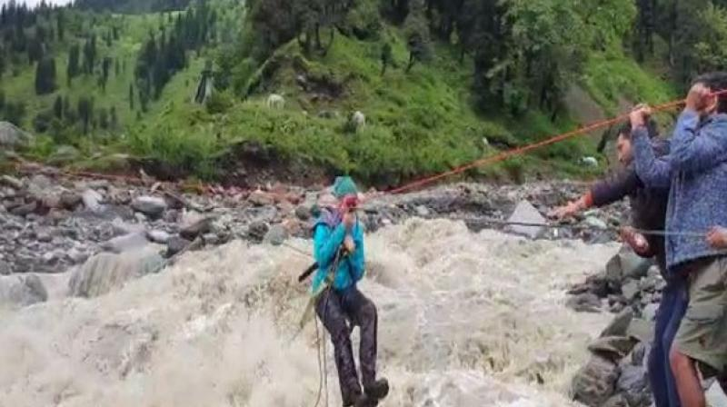 Heavy rainfall in Kullu district has brought life to a standstill. Around 60 roads across the district were blocked by landslides. Road clearing operations are being carried out by the administration. (Photo: ANI)