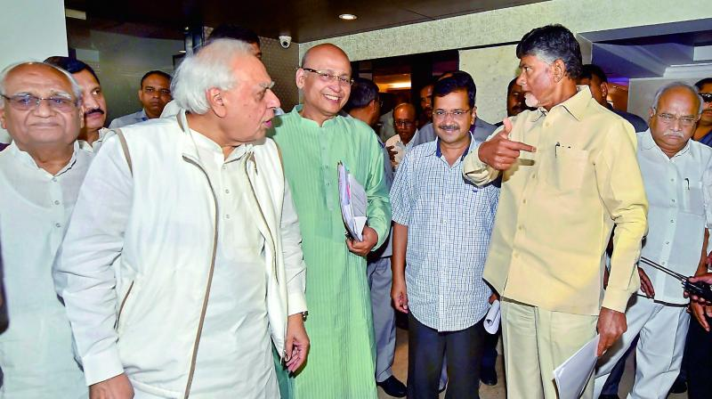 (From right) Andhra Pradesh Chief Minister N. Chandrababu Naidu with his Delhi counterpart Arvind Kejriwal, senior Congress leaders Abhishek Manu Singhvi and Kapil Sibal after a press conference in New Delhi on Sunday. (Photo: AP)