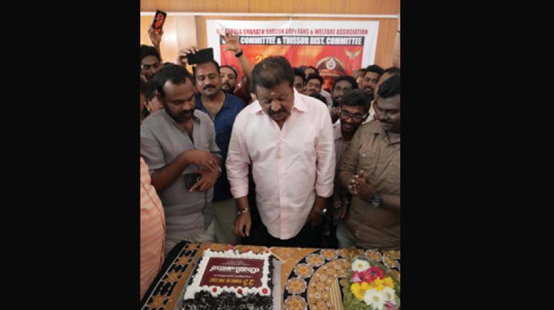 NDA candidate for Thrissur constituency Suresh Gopi cuts cake marking the 25th anniversary of the movie Commissioner at St Joseph Old Age Home at Pulazhi on Sunday.