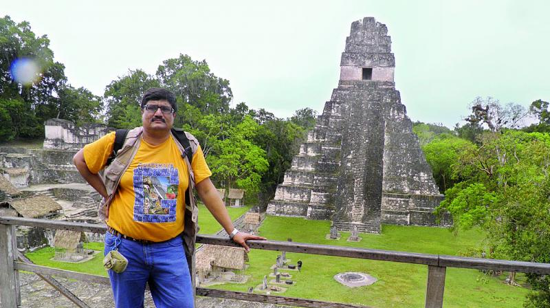 Indranil at the Tikal pyramid in Guatemala.