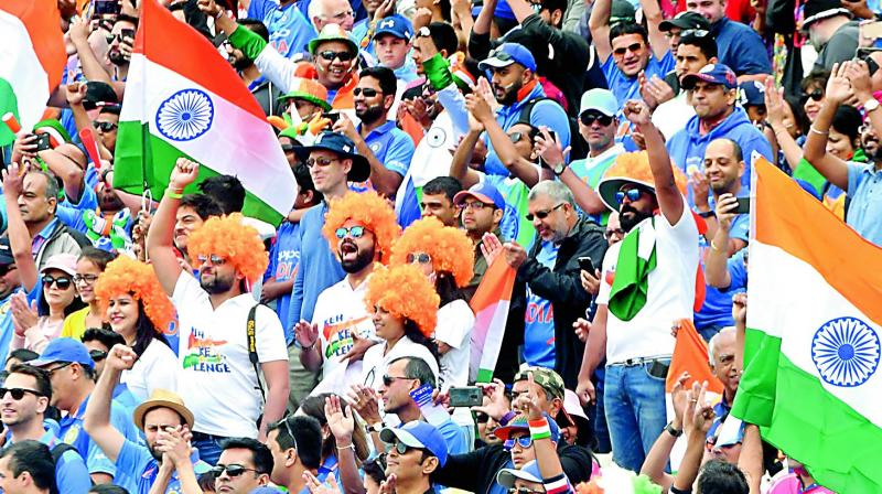 Fans cheer for Team India during the group stage match against England at Edgbaston in Birmingham on Sunday.  (AFP)