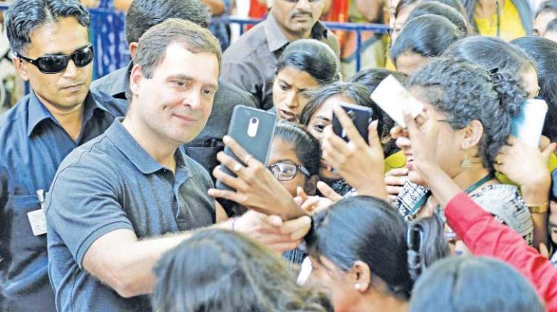 Congress president Rahul Gandhi takes a selfie with students at Stella Maris Women's College in Chennai during the LS poll campaign. (DC file photo)