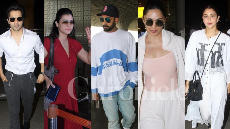 Abhishek Bachchan, Kajol, Kiara Advani, 'Sui Dhaaga' stars Varun Dhawan and Anushka Sharma were spotted at the Mumbai airport. Parineeti Chopra, Shilpa Shetty and family were clicked at Ganesh Darshan. Checkout more latest pictures of Bollywood stars right here. (Photos: Viral Bhayani)