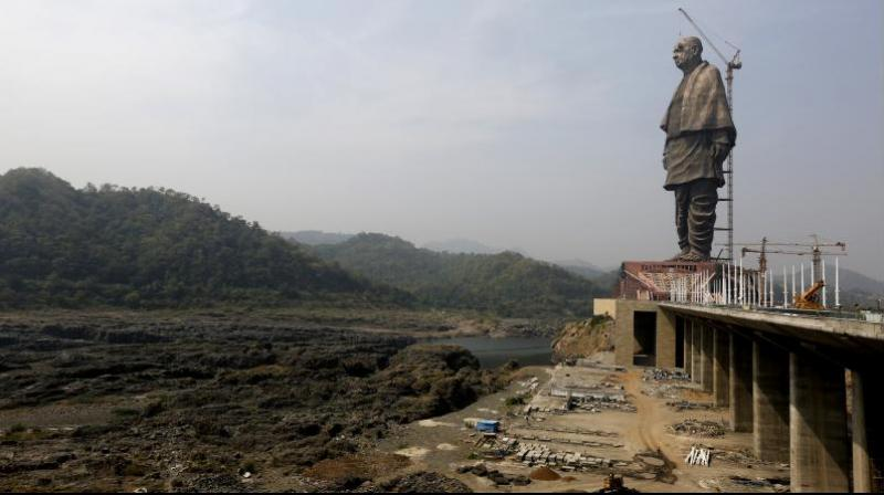 The under construction statue of unity stands facing Sardar Sarovar Dam at Kevadiya Colony, about 200 kilometers from Ahmedabad. (Photo: AP)