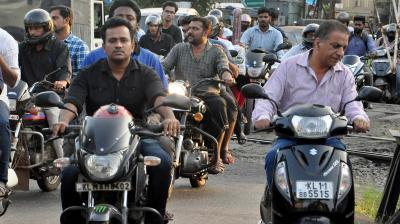 The wearing of helmets is compulsory in Tamil Nadu and the high court has come down on the police for not enforcing the law. (Photo: DC)