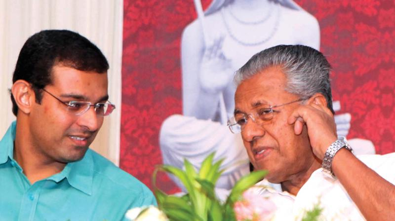 Chief Minister Pinarayi Vijayan chats with Roji M. John, MLA, during the inauguration of silver jubilee celebration of Sanskrit University in Kalady on Monday. (Photo: DC)