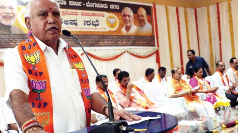 Karnataka BJP president B.S. Yeddyurappa addresses party's Shakti Kendra office-bearers in Bengaluru.