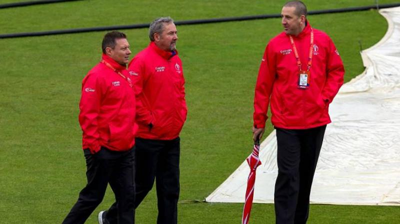 English duo of Richard Illingworth and Richard Kettleborough will officiate the first semi-final of the ICC World Cup between India and New Zealand at Manchester on Tuesday. (Photo:AFP)