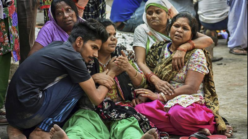 Relatives during the cremation of a victim of Friday's train accident, in Amritsar, on Sunday. (Photo: PTI)