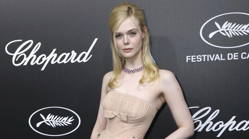 Elle Fanning Faints, Falls Off Chair at Cannes