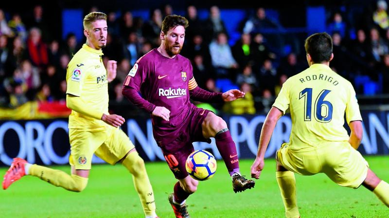 Barcelona's Messi in action against Villareal players in this file photo.