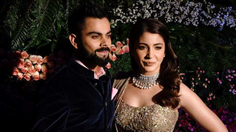 While a video of Virat Kohli and Anushka Sharma dancing with none other than Shah Rukh Khan had gone viral, a new video from the Mumbai reception, where the two are dancing on the beats of 'Mere Rashke Qamar', has taken the internet by storm. (Photo: PTI)