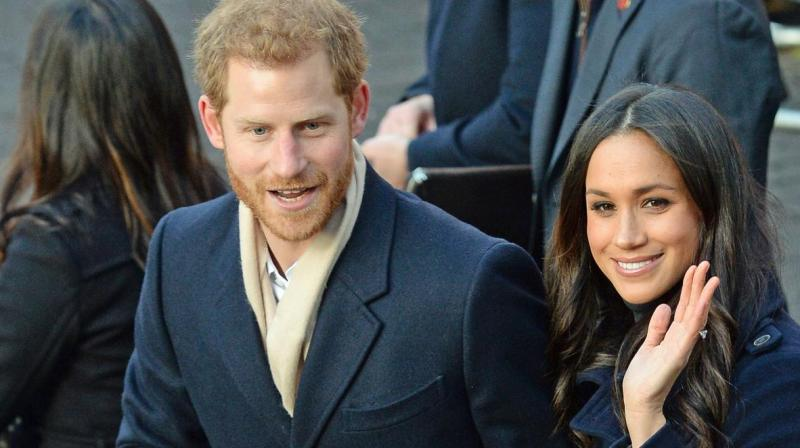 She then rushed back to Prince Harry's side, as they continued greeting the crowds. (Photo: AP)