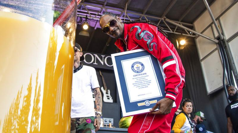 A representative from the Guinness organisation presented Snoop with his record certificate. (Photo: AP)