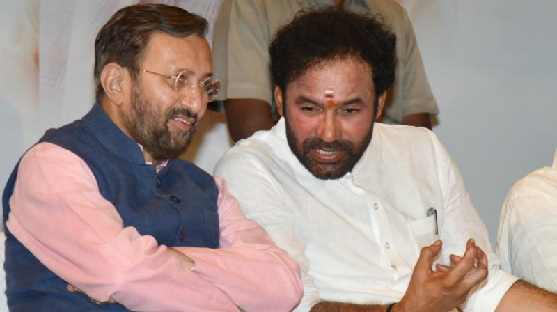 Union minister Prakash Javadekar and BJP MLA G. Kishan Reddy during the book launch on Tuesday.