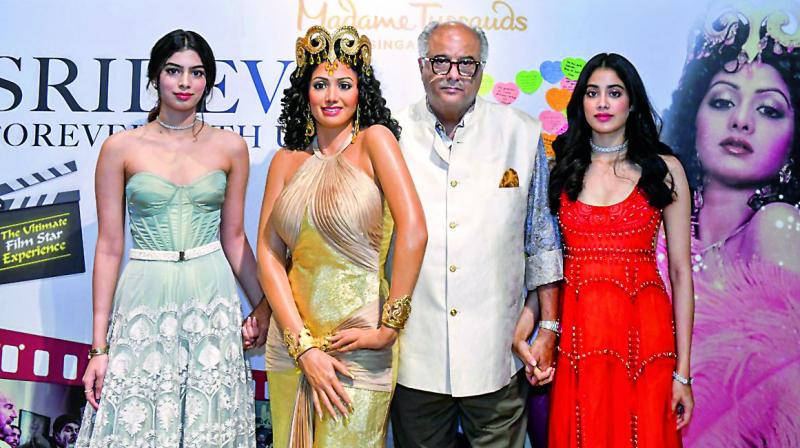 Boney, Janhvi, and Khushi Kapoor looked sombre at the unveiling of the Sridevi wax figure at Madame Tussauds in Singapore.