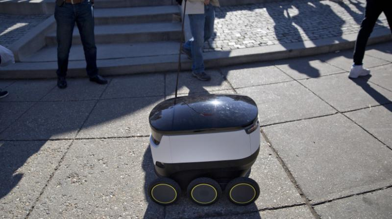 A six-wheeled ground delivery robot, from Starship Technologies, shares the sidewalk with pedestrians at DuPont Circle in Washington, D.C. Photo:AP