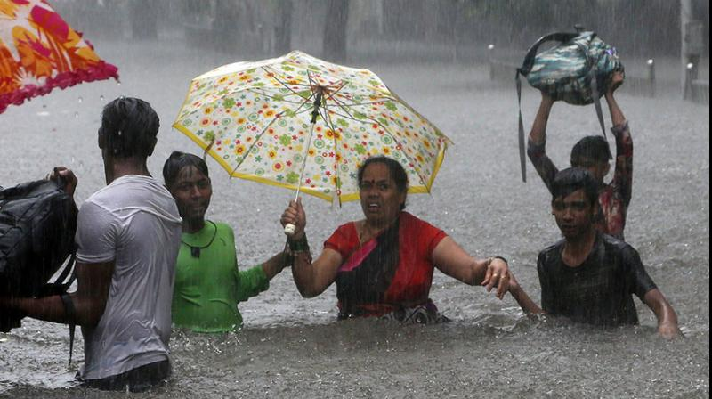 Mumbai has received 3,669.6 mm rainfall so far this season - the highest in 61 years - as against its normal quota of 2,350 mm.  (Photo: AP)