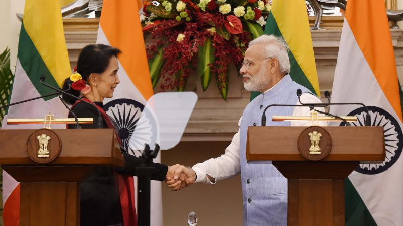 Prime Minister Narendra Modi shakes hands with Myanmar State Counsellor and Foreign Minister Aung San Suu Kyi after their joint press statement at Hyderabad House, in New Delhi. (Photo: PTI)