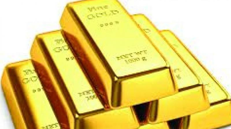 Globally, spot gold was trading marginally higher at USD 1,285.40 an ounce, while silver was up at USD 14.86 an ounce in New York. (Representational Image)