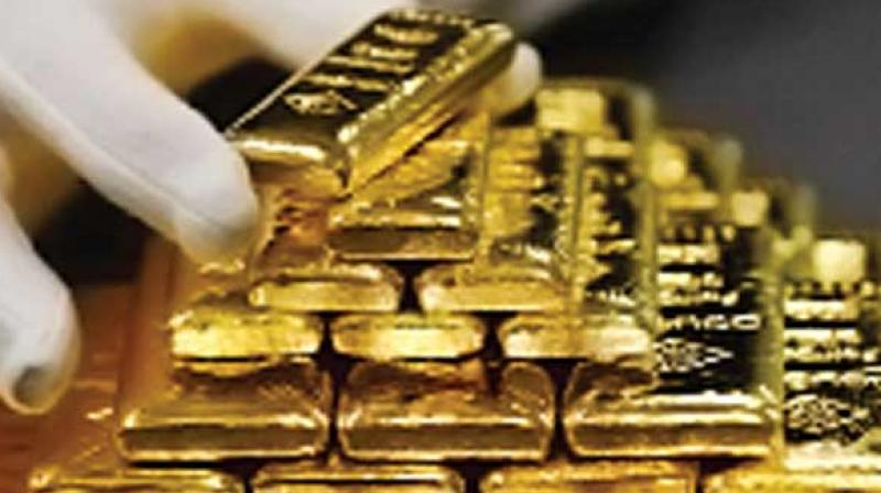 Spot gold prices for 24 Karat in Delhi were trading Rs 196 down with overnight decline in global gold prices. However, the downside was limited with sharp rupee depreciation after Moody's lowered India outlook, HDFC Securities Senior Analyst (Commodities) Tapan Patel said. (Photo: Representational)