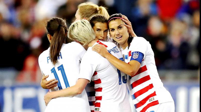 United States' Tobin Heath, second from right, is congratulated on her goal by Mallory Pugh, Megan Rapinoe and Alex Morgan during the first half of a SheBelieves Cup soccer match against Brazil in Tampa, Florida.