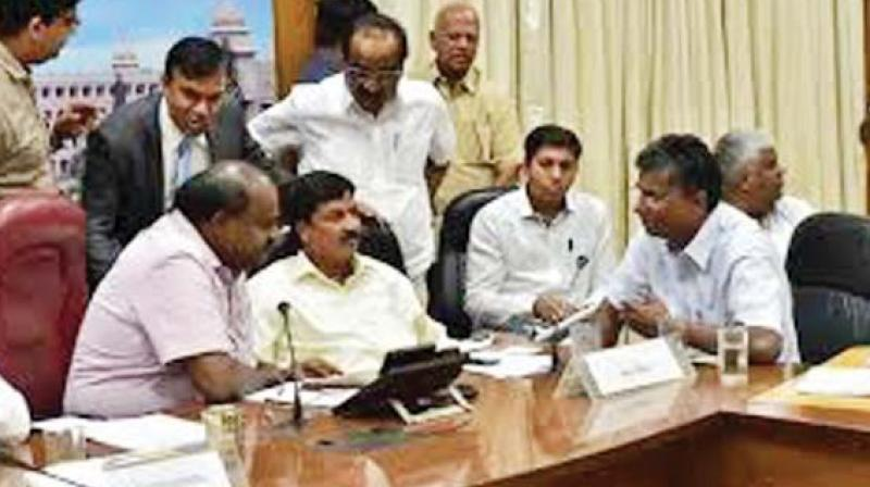 A file photo of brothers Ramesh Jarkiholi and Satish Jarkiholi with Chief Minister H.D. Kumaraswamy during a meeting