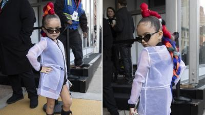 Taylen Biggs, 6, poses for photos outside of a show during Fashion Week in New York. AP Photo