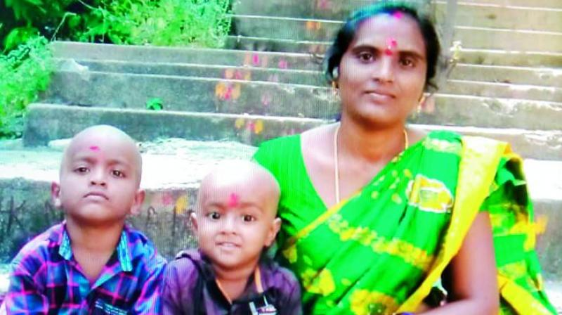 C. Saroja with her kids.