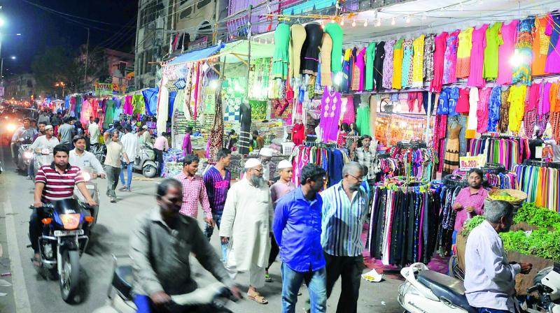 Muslims throng Tolichowki market on Saturday to purchase goods for Id as the month of Ramzan is coming to an end.