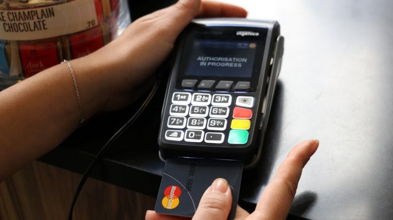 All you need to do is place your authorised finger on the sensor patch of the card while the payment terminal/machine asks for your confirmation for the transaction that you are undertaking. (image: engadget)