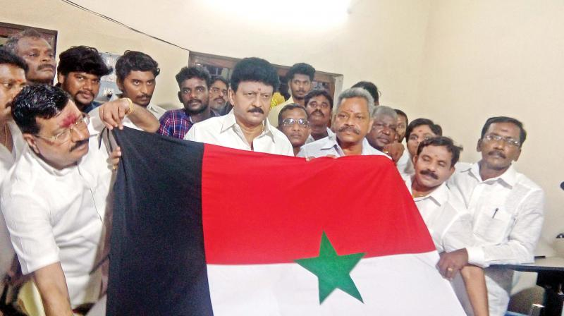 Divaharan introduces his party flag after formally launching his new political outfit ADK  at Mannargudi  on Sunday. (Photo: DC)