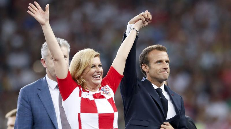 Croatian president Kolinda Grabar Kitarovic, clad in a red-and white Croatia soccer shirt, stood on the podium with Russian President Vladimir Putin and French President Emmanuel Macron when the medals were given to the players. (Photo: AP)
