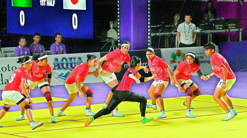 Indian women kabaddi players try to trap a Japanese raider during their match on Sunday. India won 43-12. (Photo: AFP)
