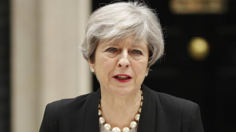 May says the Conservatives will build a 'stronger, fairer and more prosperous Britain,' while opposition Labour leader Jeremy Corbyn says he would govern 'for the many, not the few.' (Photo: AP)