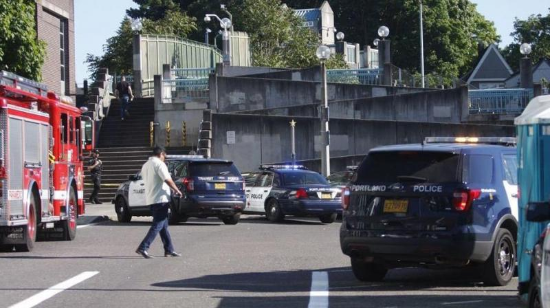 Police investigate a deadly stabbing on a Metropolitan Area Express train in northeast Portland, Oregon on Friday. (Photo: AP)