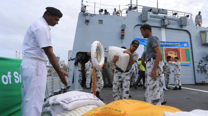 Pakistan Navy soldiers of PNS Zulfiquar unload relief materials to be used in the flood affected areas, Colombo, Sri Lanka, Tuesday, May 30, 2017. Mudslides have become common during Sri Lanka's summer monsoon season as forests across the tropical Indian Ocean island nation have been cleared for export crops such as tea and rubber. (Photo: AP)